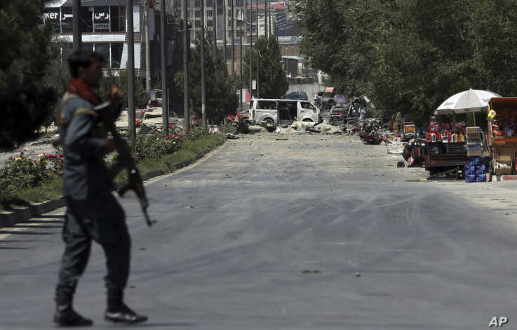 A security forces soldier arrives at the site of an explosion in Kabul, Afghanistan, Monday, July 1, 2019. A powerful bomb blast rocked the Afghan capital early Monday, rattling windows, sending smoke billowing from Kabul's downtown area and…