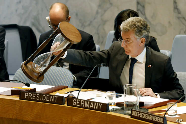 Germany's Ambassador and current president of the Security Council Christoph Heusgen resets an hour glass between speakers at United Nations headquarters, Monday, April 29, 2019. (AP Photo/Richard Drew)
