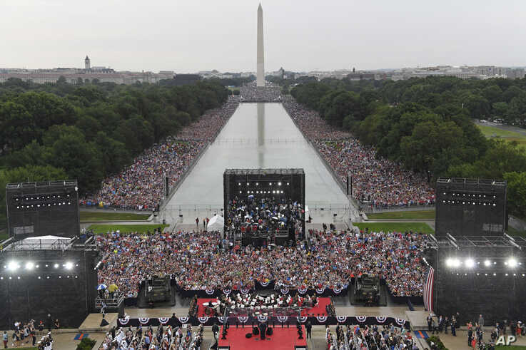 President Donald Trump speaks during an Independence Day celebration in front of the Lincoln Memorial in Washington, July 4, 2019. The Washington Monument and the reflecting pool are in the background.