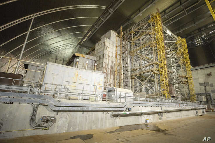 """A view inside the """"new safe confinement"""" shelter that spans the remains of the Chernobyl nuclear power plant's Reactor No. 4, in Chernobyl, Ukraine, Wednesday, July 10, 2019. A structure built to confine radioactive dust from the nuclear reactor at…"""