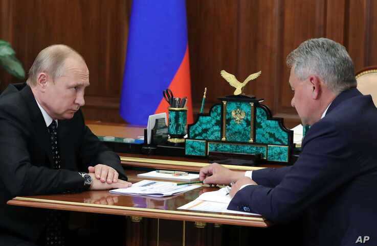 Russian President Vladimir Putin, left, listens to Russian Defense Minister Sergei Shoigu during their meeting in the Kremlin in Moscow, Russia, Thursday, July 4, 2019. Some crew members survived a fire that killed 14 sailors on one of the Russian…