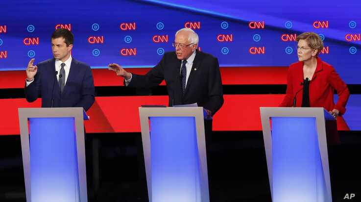 South Bend Mayor Pete Buttigieg, Sen. Bernie Sanders, I-Vt., and Sen. Elizabeth Warren, D-Mass., participate in the first of two Democratic presidential primary debates hosted by CNN Tuesday, July 30, 2019, in the Fox Theatre in Detroit. (AP Photo…