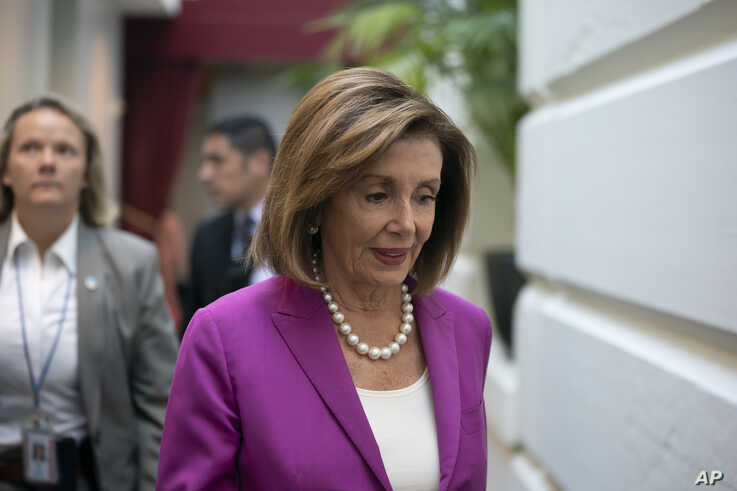 "House Speaker Nancy Pelosi, D-Calif., arrives for a closed-door session with her caucus before a vote on a resolution condemning what she called ""racist comments"" by President Donald Trump at the Capitol in Washington, Tuesday, July 16, 2019. His…"