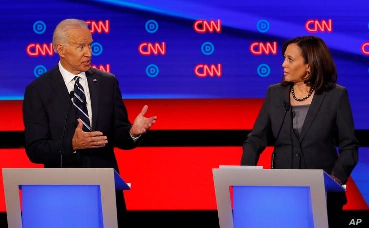 Sen. Kamala Harris, D-Calif., listens as former Vice President Joe Biden speaks during the second of two Democratic presidential primary debates hosted by CNN, July 31, 2019, in the Fox Theatre in Detroit.