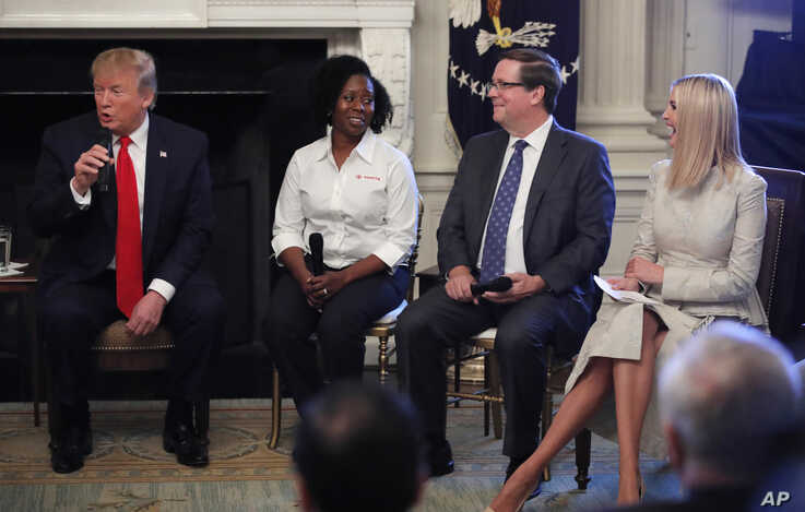 """From left, President Donald Trump, joined by Shameka Whaley Green of Toyota, Jim Lentz, CEO of Toyota North America, and his daughter Ivanka Trump speaks during a """"Pledge to America's Workers"""" ceremony in the White House in Washington, July 25, 2019."""