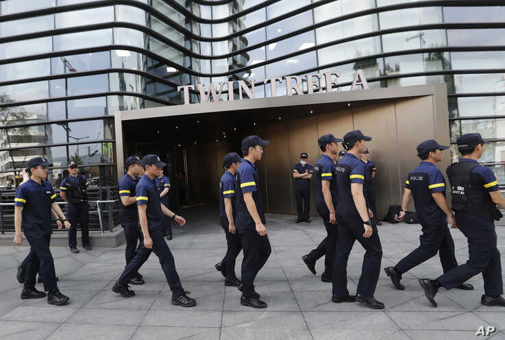 South Korean police officers patrol against possible rallies against Japan in front of the building where the Japanese embassy is located in Seoul, South Korea, July 19, 2019. A man set himself on fire in front of the Japanese Embassy in Seoul amid rising trade disputes between Seoul and Tokyo.