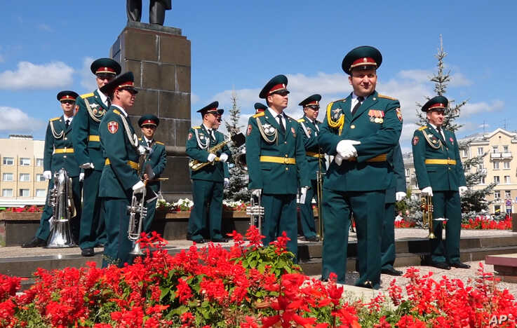 In this grab taken from a footage provided by the ROSATOM press service, a Russian military band prepare to attend the funerals of 5 Russian nuclear engineers, Aug. 12, 2019.