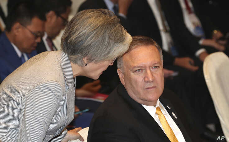 South Korea's Foreign Minister Kang Kyung-wha, left, talks to U.S. Secretary of State Mike Pompeo before the East Asia Summit meeting in Bangkok, Thailand, Aug. 2, 2019.