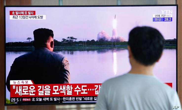 A man watches a TV showing a file image of a North Korea's missile launch during a news program at the Seoul Railway Station in Seoul, South Korea, Tuesday, Aug. 6, 2019. North Korea on Tuesday continued to ramp up its weapons demonstrations by…