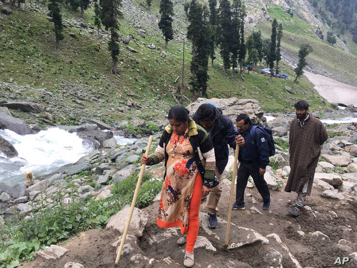 In this Saturday, July 27, 2019, photo, Hindu pilgrims walk uphill as they participate in the annual amarnath pilgrimage near Chandanwa, Indian controlled Kashmir. India is pitching a Hindu pilgrimage to a snowy cave shrine in disputed, Muslim…