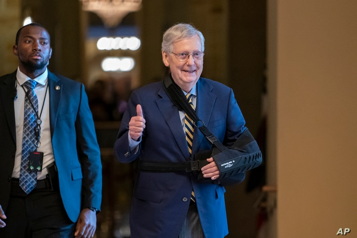 Senate Majority Leader Mitch McConnell, R-Ky., walks to the Senate chamber with his arm in a sling after he suffered a broken shoulder in a fall at his home during the August recess, at the Capitol in Washington, Monday, Sept. 9, 2019. Congress…