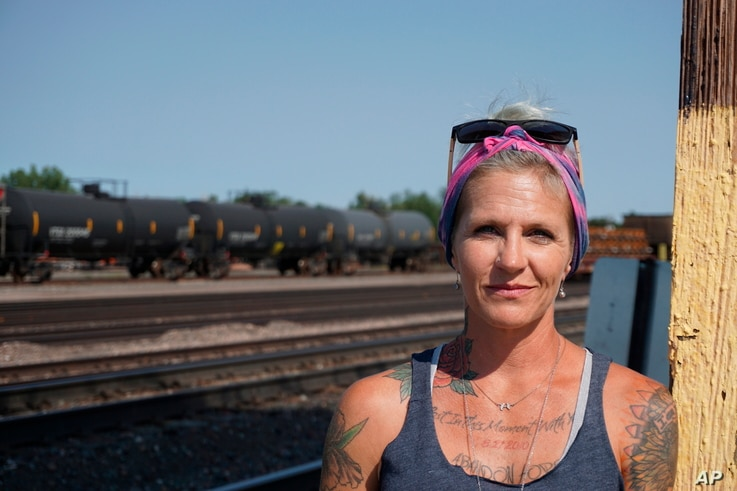 In this Thursday, Sept. 5, 2019 photo Blackjewel warehouse technician Melissa Worden, poses for a photo in Gillette, Wyo. The shutdown of Blackjewel LLC's Belle Ayr and Eagle Butte mines in Wyoming since July 1, 2019 has added yet more uncertainty…