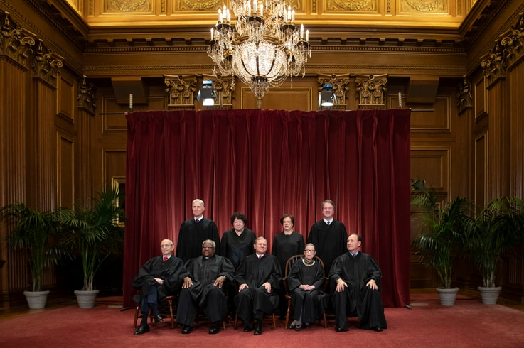 FILE - In this Nov. 30, 2018, file photo, the justices of the U.S. Supreme Court gather for a formal group portrait to include a new Associate Justice, top row, far right, at the Supreme Court Building in Washington. Seated from left: Associate…