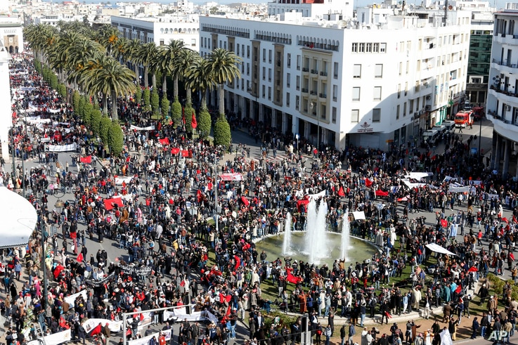 """FILE - In this Sunday, March 13, 2016 file photo, protesters chant slogans through speakers at a rally in Rabat, Morocco as they accuse U.N. Secretary-General Ban Ki-moon of """"abandoning neutrality, objectivity and impartiality"""" during a recent visit…"""