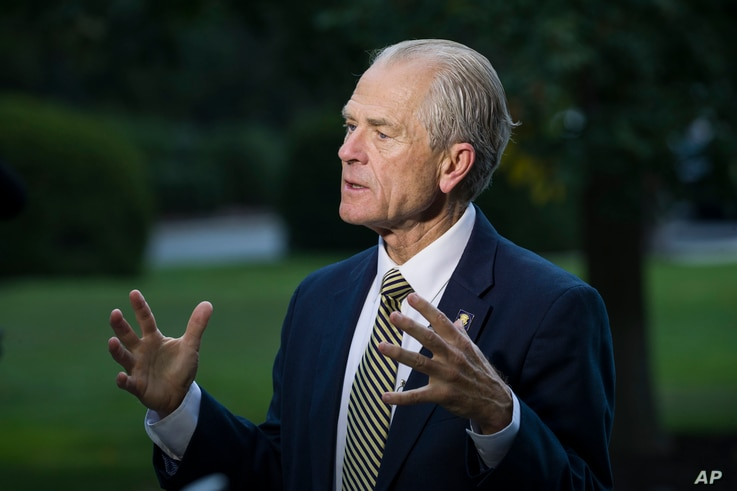 FILE - In this file photo dated Wednesday, Sept. 11, 2019, U.S. White House trade adviser Peter Navarro speaks during a television interview at the White House, in Washington, U.S.A.  The U.S. is threatening to pull the United States out of the 145…