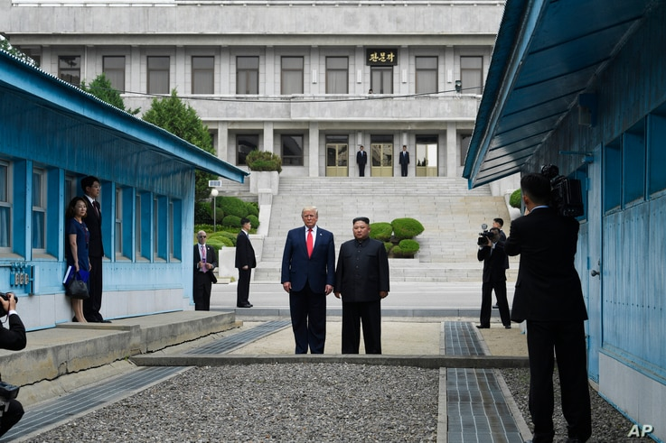 FILE - In this June 30, 2019, file photo, President Donald Trump meets with North Korean leader Kim Jong Un at the border village of Panmunjom in the Demilitarized Zone, South Korea. Trump, the self-styled deal-maker president, is struggling to…