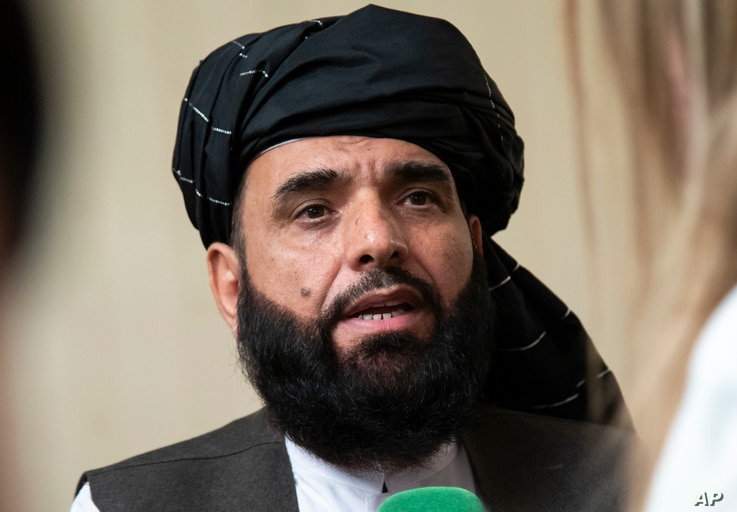 FILE - In this May 28, 2019 file photo, Suhail Shaheen, spokesman for the Taliban's political office in Doha, speaks to the media in Moscow, Russia. Afghanistan's Taliban leaders agreed they wanted a deal with the United States, but some among them…