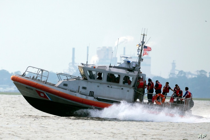 A United States Coast Guard vessel heads back to base with several members of the rescue team aboard after the last crew member was reportedly removed safely from the capsizes cargo shop Golden Ray, Monday, Sept. 9, 2019, in Jekyll Island, Ga. Three…