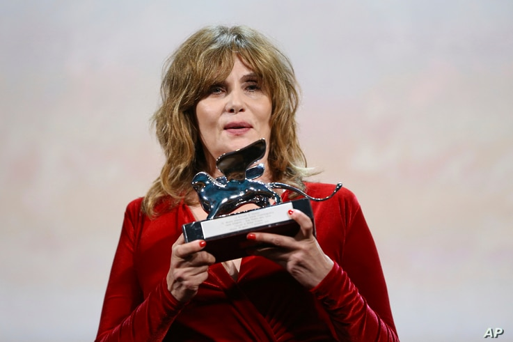 Actress Emmanuelle Seigner holds the Silver Lion Grand Jury Prize for the film 'An Officer and a Spy' on behalf of her husband Roman Polanski at the closing ceremony of the 76th edition of the Venice Film Festival, Venice, Italy, Saturday, Sept. 7,…