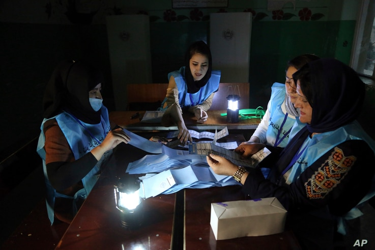 Afghan election workers count ballots during the presidential elections, at a polling station in Kabul, Afghanistan, Saturday, Sept. 28, 2019. Afghans headed to the polls on Saturday to elect a new president amid high security and Taliban threats to…