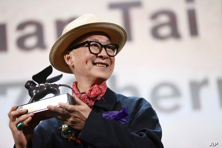 Director and writer Yonfan, holds the award for Best Screenplay for the film 'No. 7 Cherry Lane at the closing ceremony of the 76th edition of the Venice Film Festival, Venice, Italy, Saturday, Sept. 7, 2019. (Photo by Joel C Ryan/Invision/AP)