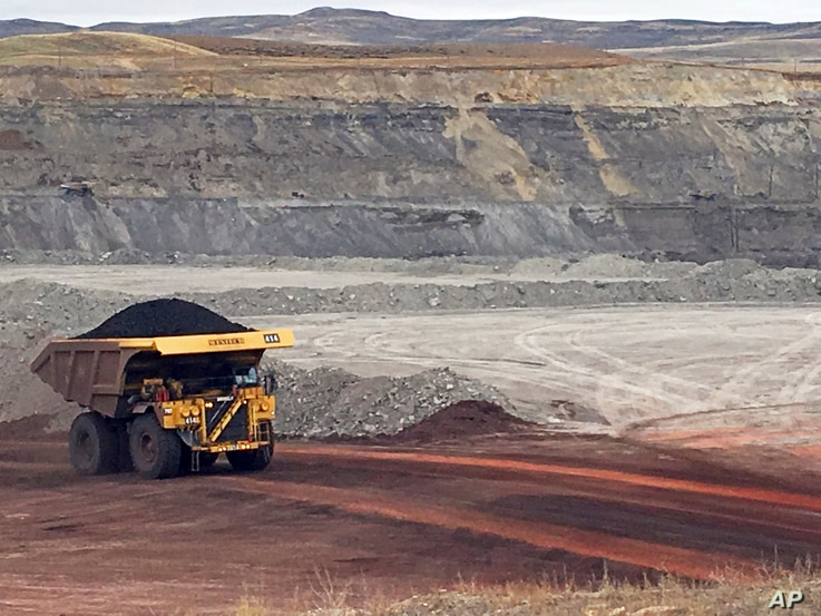 A dump truck hauls coal Tuesday, March 28, 2017, at Contura Energy's Eagle Butte Mine near Gillette, Wyo. President Donald Trump's lifting of a federal coal lease moratorium will allow new coal leasing to resume at the mine and others in the Powder…