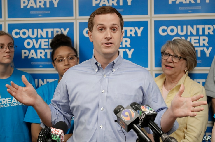 Ninth Congressional district Democratic candidate speaks during a news conference in Charlotte, N.C., Wednesday, May 15, 2019. McCready faces Republican Dan Bishop, as well as Libertarian and Green candidates, on Sept. 10. (AP Photo/Chuck Burton)