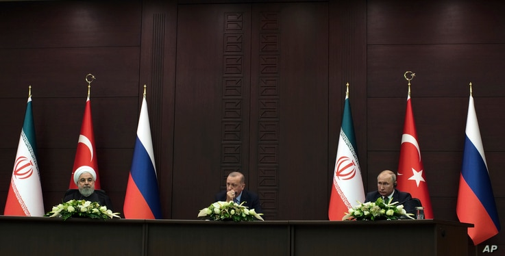 Turkish President Recep Tayyip Erdogan, center, Russia's President Vladimir Putin, right, and Iran's President Hassan Rouhani speak to the media at a news conference in Ankara, Turkey, Monday, Sept. 16, 2019. The leaders of Russia, Iran and Turkey…