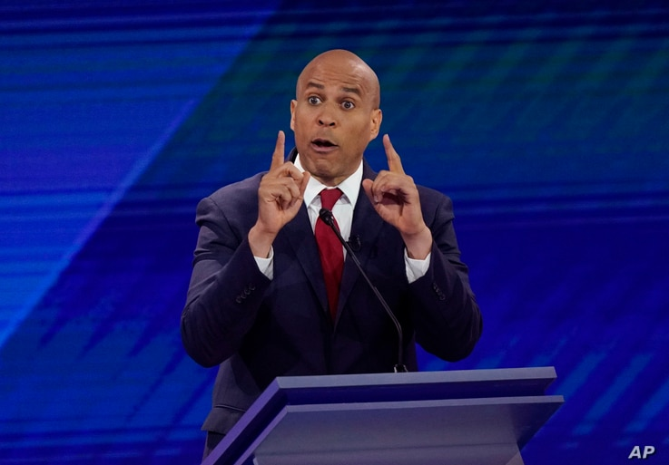 Sen. Cory Booker, D-N.J., responds to a question Thursday, Sept. 12, 2019, during a Democratic presidential primary debate hosted by ABC at Texas Southern University in Houston. (AP Photo/David J. Phillip)