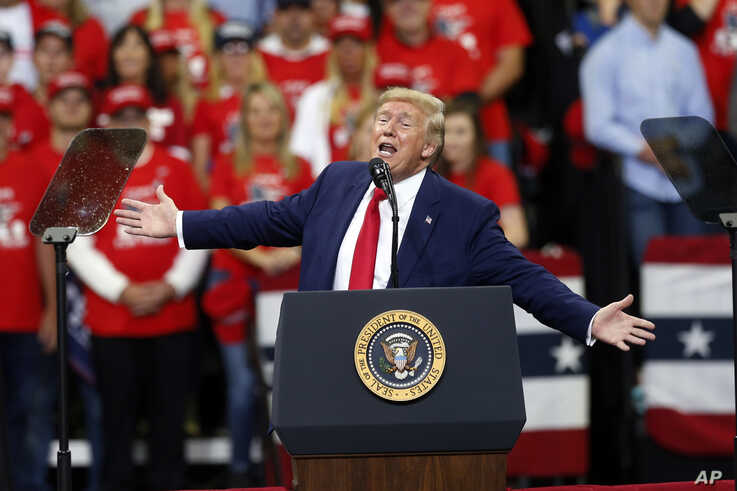 President Donald Trump addresses a campaign rally Thursday, Oct. 10, 2019, in Minneapolis. (AP Photo/Jim Mone)