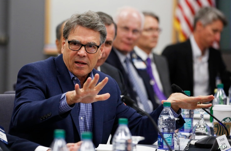 Energy Secretary Rick Perry, left, speaks at a roundtable discussion among the government agencies, the private sector and…