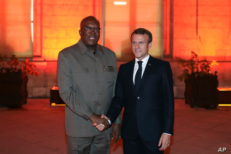 France's President Emmanuel Macron shakes hands with Burkina Faso's President Roch Marc Christian Kabore at the Lyon's city…
