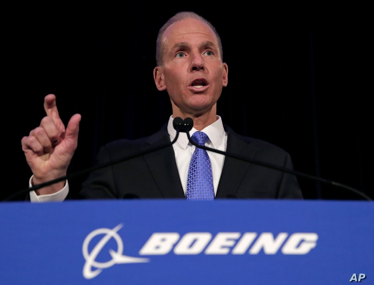 FILE - In this Monday, April 29, 2019 file photo, Boeing Chief Executive Dennis Muilenburg speaks during a news conference…