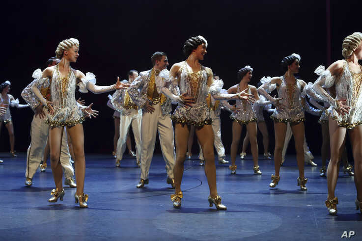 Dancers perform during the curtain call on the opening night of the musical 42nd Street, in aid of East Anglia's Children's…