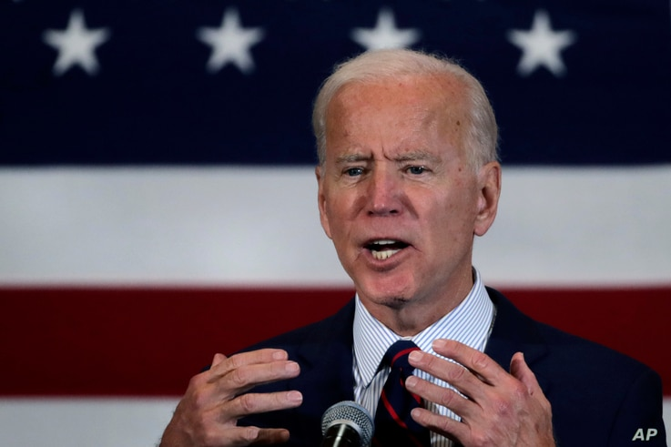 Democratic presidential candidate former Vice President Joe Biden gestures during a campaign stop in Manchester, N.H.,…