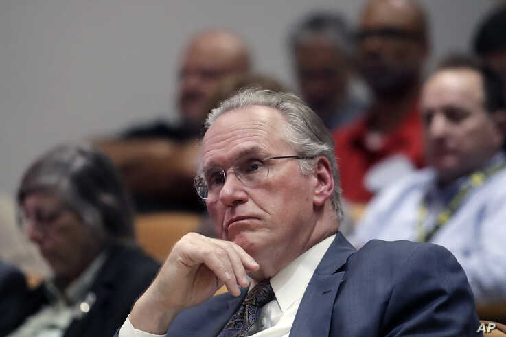 Pacific Gas and Electric Company (PG&E) CEO Bill Johnson listens to speakers during a California Public Utilities Commission…