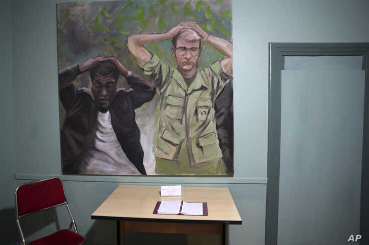 In this Sept. 26, 2019, photo, a painting of one of the images of the takeover of U.S. Embassy in Tehran in 1979 which shows U…
