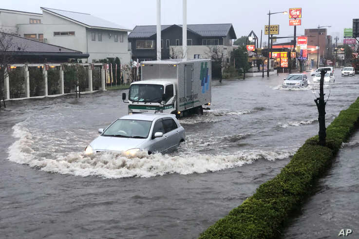 A street is flooded by heavy rain Friday, Oct. 25, 2019, in Narita, east of Tokyo. Torrential rain dumped from a low-pressure…