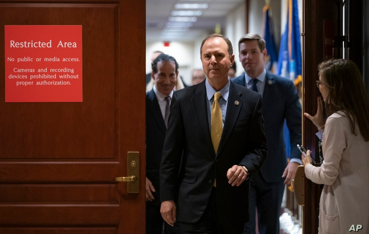 House Intelligence Committee Chairman Adam Schiff, D-Calif., followed by Rep. Jamie Raskin, D-Md., left, and Rep. Eric Swalwell…