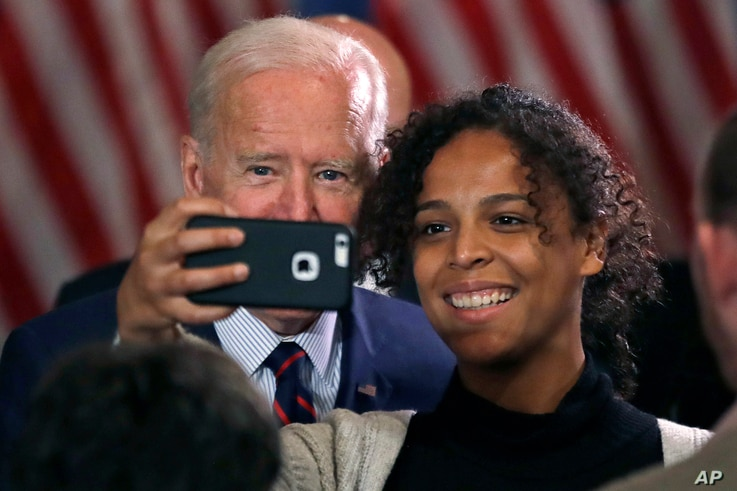 Democratic presidential candidate and former Vice President Joe Biden takes a selfie at a campaign event, Wednesday, Oct. 9,…