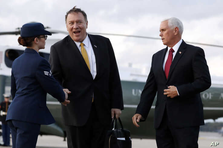 Vice President Mike Pence and Secretary of State Mike Pompeo arrive at Andrews Air Force Base, Md., Wednesday, Oct. 16, 2019,…