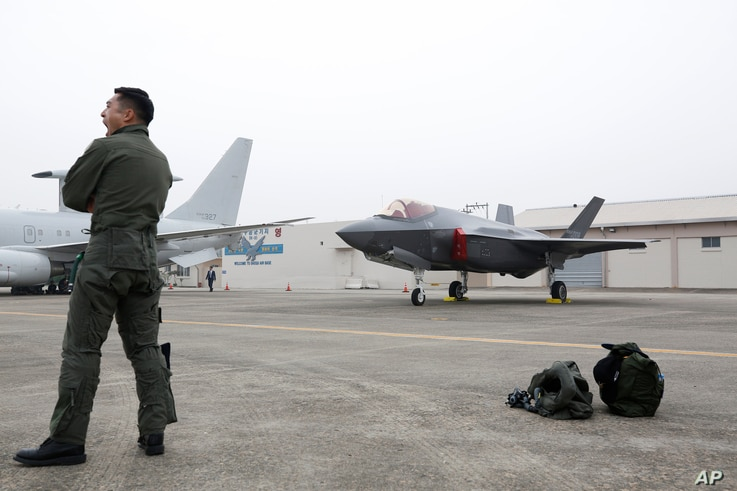 A South Korean fighter pilot stands near F-35 A Stealth in the 71st anniversary of Armed Forces Day at the Air Force Base in Daegu, South Korea Tuesday, Oct. 1, 2019. (Jeon Heon-kyun/Pool Photo via AP)