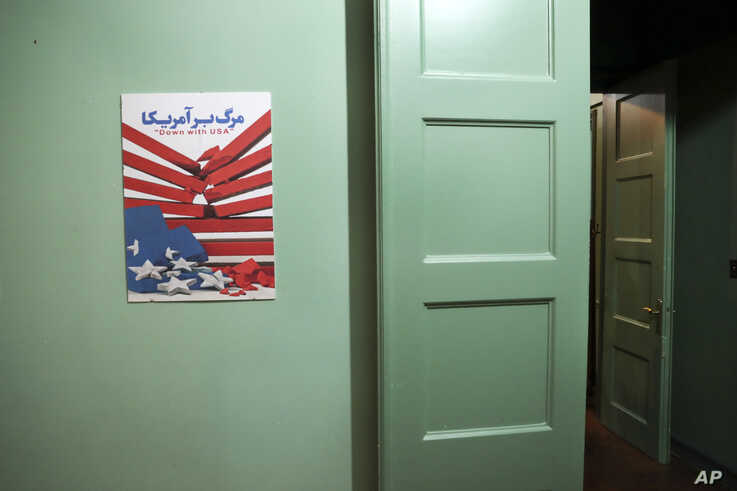 In this Sept. 26, 2019 photo, an anti-U.S. placard adorns a corridor of the former U.S. Embassy in Tehran, now partly a museum,…