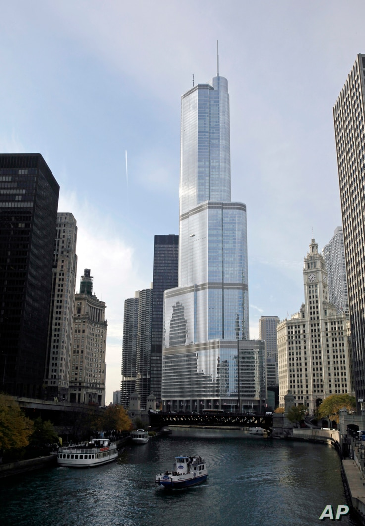In this Nov. 8, 2013 file photo, boats move along the Chicago River near the Trump International Hotel and Tower, center, in…