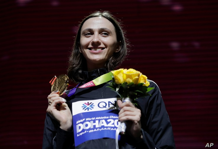 FILE - In this Tuesday, Oct. 1, 2019 file photo, Gold medalist Mariya Lasitskene, who participates as a neutral athlete, poses…