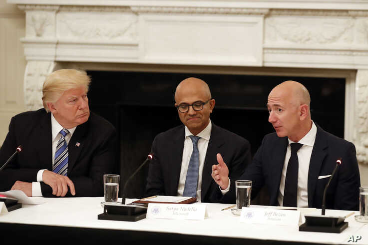 FILE - In this June 19, 2017, file photo, President Donald Trump, from left, and Satya Nadella, Chief Executive Officer of…