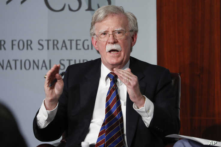 FILE - In this Sept. 30, 2019, file photo, former national security adviser John Bolton gestures while speakings at the Center…