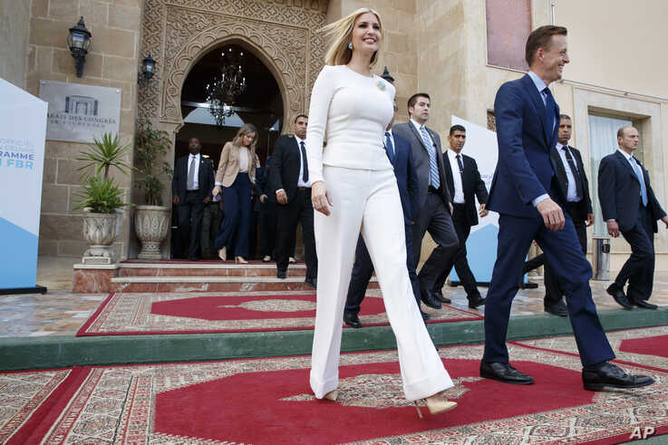 """Ivanka Trump, the daughter and senior adviser to President Donald Trump, left, leaves an event at the """"Palais des Congres,""""…"""