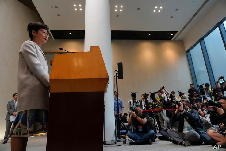 Hong Kong Chief Executive Carrie Lam, left, speaks during a press conference in Hong Kong, Tuesday, Nov. 26, 2019. Lam has…