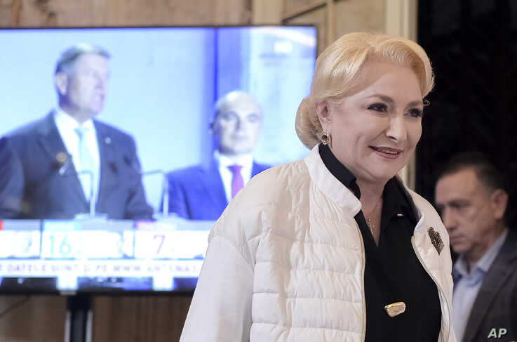 Former Romanian Prime Minister Viorica Dancila smiles before a statement after exit polls indicate her as the runner up of the…